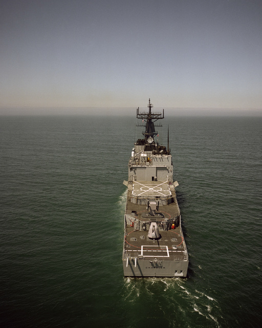 A stern view of the guided missile destroyer USS CHANDLER (DDG 996) underway