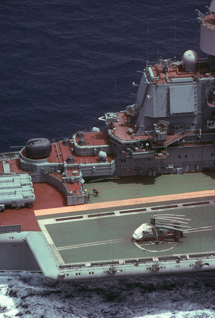 An aerial view of radar equipment on the forward portion of the island superstructure of the Soviet Kiev class VSTOL aircraft carrier BAKU (CVHG 103).  Radar installations on the Baku exhibit extensive technological changes from the other three Kiev class carriers.  A Ka-27 Helix helicopter is parked on the flight deck