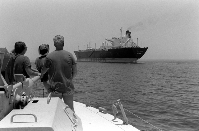 Members of Special Boat Unit 11 observe the SS GAS PRINCE from the bow of their PB Mark III patrol boat as it approaches the SS GAS PRINCE. The SS GAS PRINCE is participating in an Earnest Will convoy mission where reflagged Kuwaiti tankers are escorted through the waters of the Gulf by U.S. naval ships