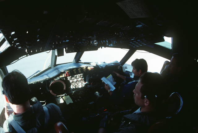 P-3 Orion crew members from Patrol Squadron 68 (VP-68), left to right, Commander (CDR) Cole, Aviation Electrician's Mate First Class (AE1) Ben Howard, and Lieutenant (LT) Winters, prepare for take off