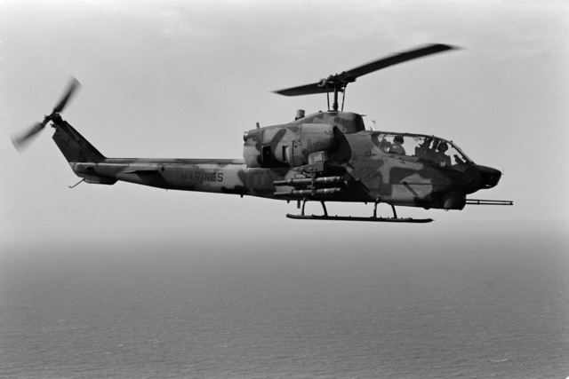 An air-to-air right side view of an AH-1 Sea Cobra helicopter from Marine Utility/Attack Helicopter Squadron 167 (HML/A-167), Marine Air Group Tactical Force 2-88 (MAGTF 2-88)