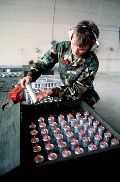 An airmen removes a flare from a storage container during the Pacific Air Forces (PACAF) combat ammunition production and combat aircraft servicing competition Sabre Spirit '88