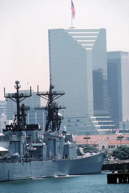High-rise buildings tower over the destroyer USS CUSHING (DD-985)