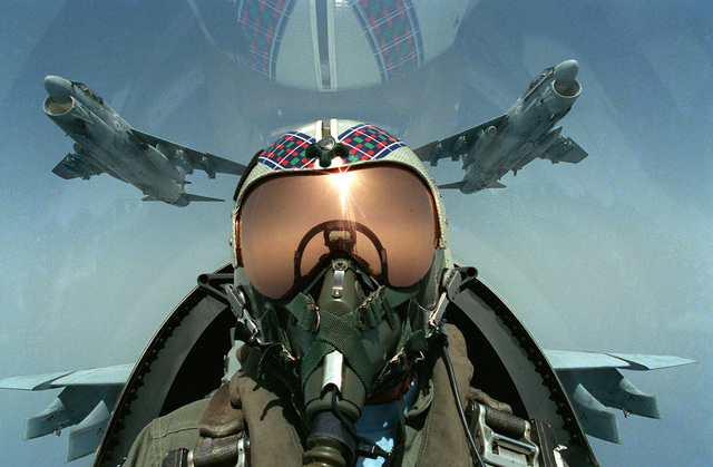 A pilot takes a self portrait from the cockpit of an Attack Squadron 46 (VA-46) A-73 Corsair II aircraft. Carrier Air Wing 7 (CVW-7) is assigned to the nuclear-powered aircraft carrier USS DWIGHT D. EISENHOWER (CVN-69), which is in the Mediterranean Sea o