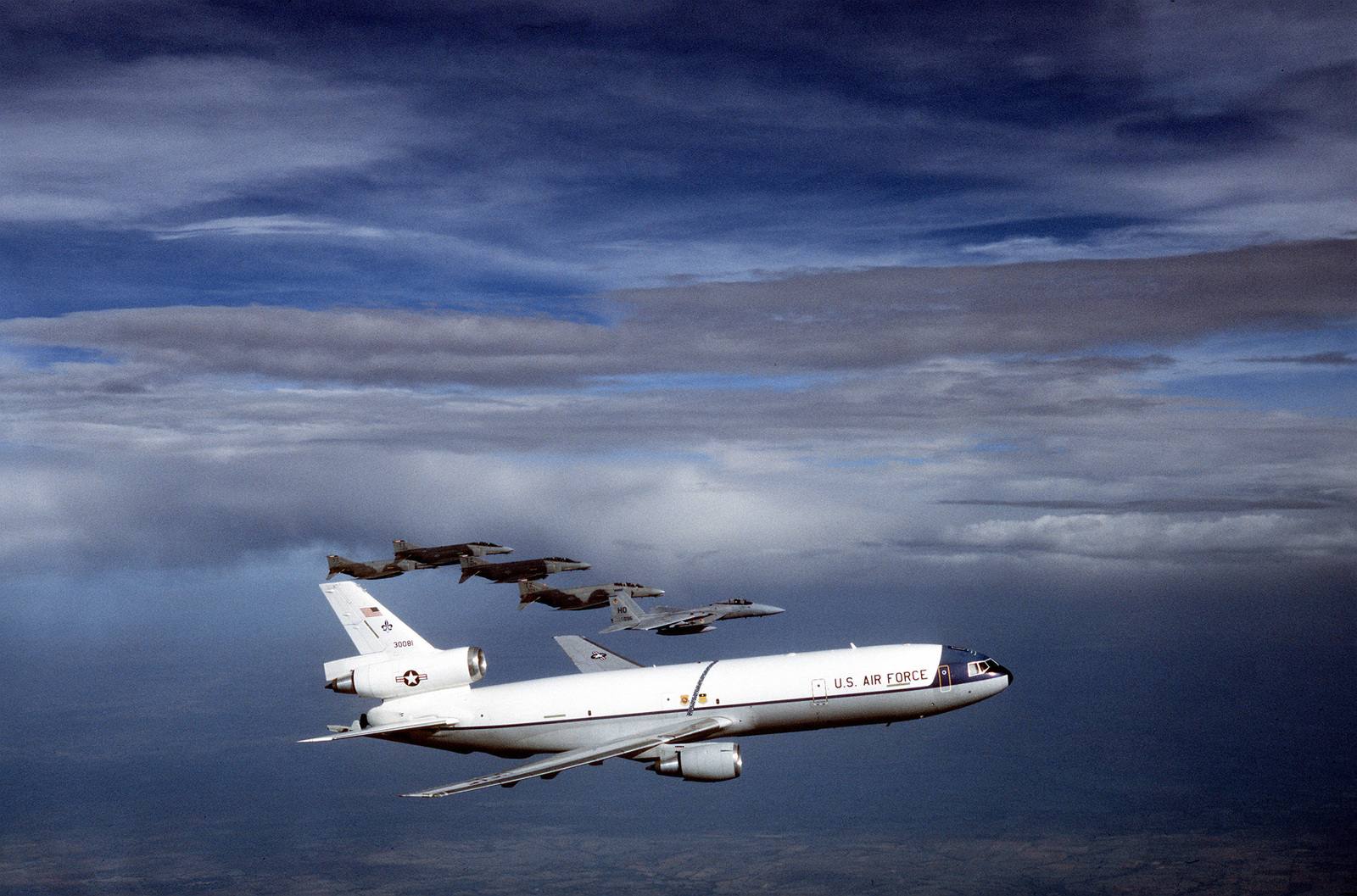 Air to air view of an Air Mobility Command's KC-10 Extender in formation with a Holloman Air Force Base, New Mexico, 49th Tactical Fighter Wing F-15 Eagle and three F-4 Phantoms from Tyndall Air Force Base, Florida. Exact Date Shot Unknown