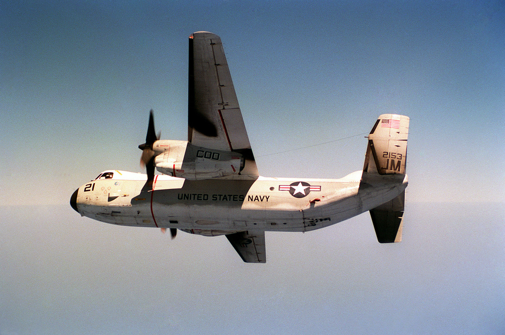 An air-to-air left side view of a C-2A Greyhound carrier on-board delivery (COD) aircraft from Fleet Logistic Support Squadron 24 (VR-24) as it banks into a turn.  The aircraft, which is based at Naval Air Station, Sigonella, Sicily, is flying in support of the Nuclear-powered Aircraft Carrier USS DWIGHT D. EISENHOWER (CVN 69)