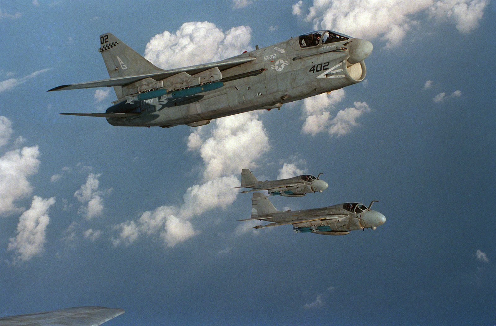 An air-to-air right side view of an Attack Squadron 46 (VA-46) A-7E Corsair II and two attack Squadron 34 (VA-34) A-6E Intruders.  Carrier Air Wing 7 (CVW-7) is assigned to the nuclear-powered aircraft carrier USS DWIGHT D. EISENHOWER (CVN 69), which is i