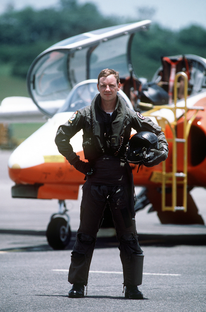 CPT Dave Elliott stands in front of an Italian-built SIAI-Marchetti S-211 trainer aircraft which he flies as an exchange pilot with the Singapore air force
