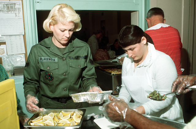 SSGT Virginia Placencia, coordinator for the Meals on Wheels Program at Castle Air Force Base, works with local volunteers to make certain meal deliveries are on time. Military personnel from Castle take an active role in helping the programs of Project Cherish, a community support program for the elderly and shut-in of Atwater