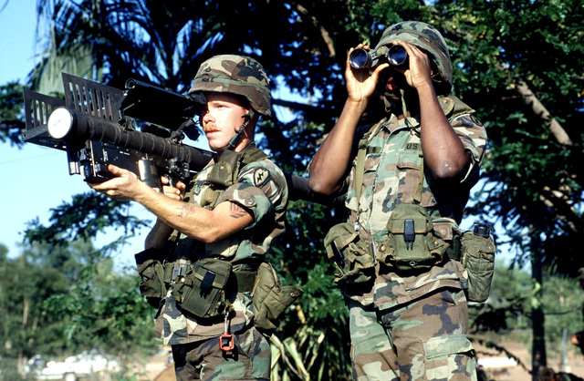 A member of the 1ST Battalion, 62nd Air Defense Artillery, shoulders a Stringer missile launcher, as his partner peers through a pair of field binoculars during PITCH BLACK '88, a joint Australia-US Exercise emphasizing night flying