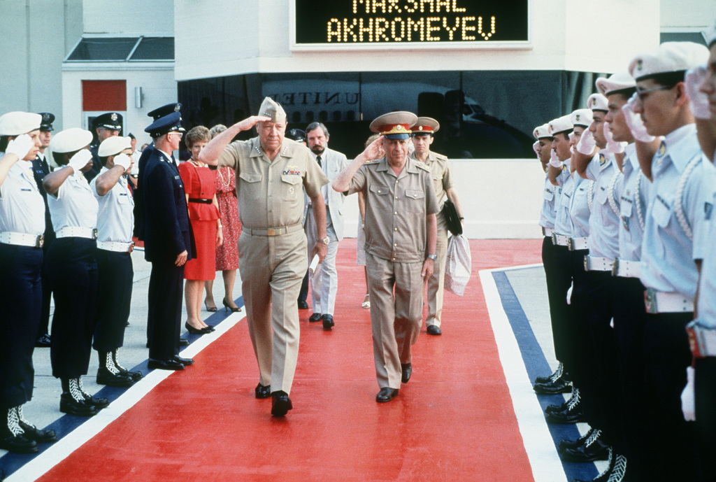 Admiral (ADM) William J. Crowe Jr., Chairman of the Joint Chiefs of STAFF, Marshal Sergei F. Akhromeyev, First Deputy Minister of Defense and CHIEF of the General STAFF of the Soviet Union, and their entourage return the honor guards'salute as the marshal