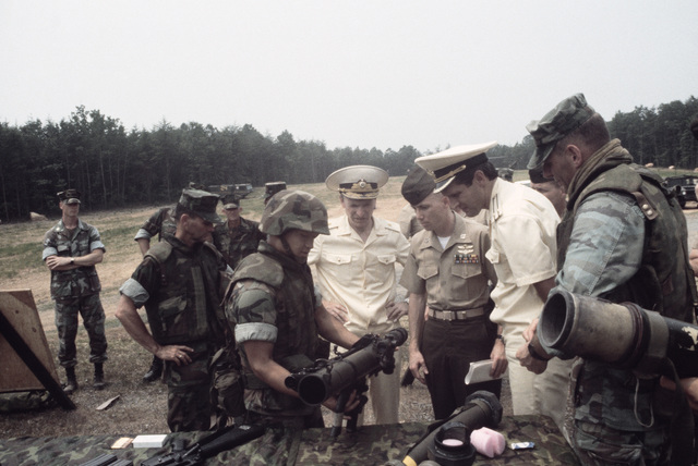 Lance Corporal (LCPL) Toull, Weapons Platoon, The Basic School, explains the M47 Dragon medium anti-tank/assault weapon to Soviet officials during their visit to the base