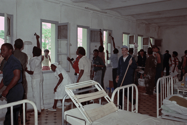Crew members from the tank landing ship USS SUMTER (LST 1181) help local residents paint the interior of a hospital during a community relations project.  The SUMTER is visiting the city during a six-month West African training cruise