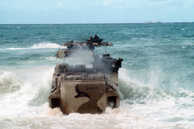 Three AAVP-7 Assault Amphibian Vehicles (AAVs) enter the surf as they return to their ship at the conclusion of Exercise RimPac '88. The AAVs are originally from Marine Corps Base, 29 Palms, Calif