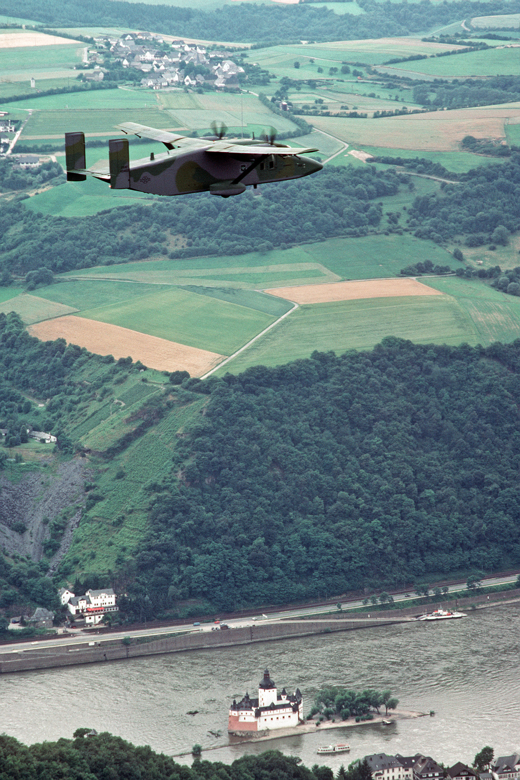 A 10th Military Airlift Squadron C 23 Sherpa Aircraft Flies Over The Airplane Parts Rhein River En