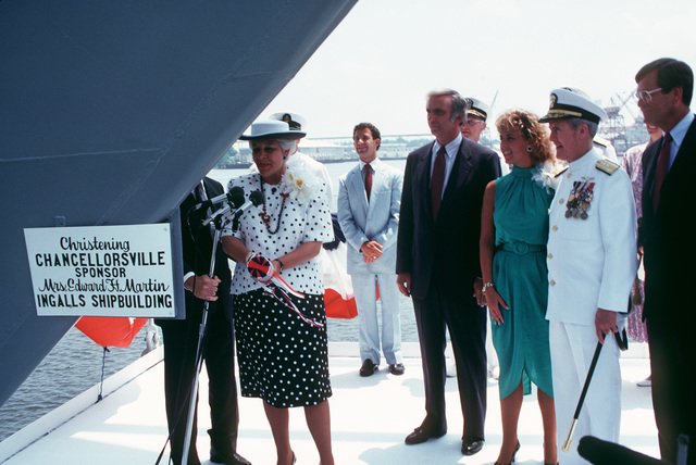 Mrs. Edward H. Martin, ship's sponsor, prepares the christen the Aegis guided missile cruiser USS CHANCELLORSVILLE (CG 62).  Jerry St. Pe, senior vice president, Litton and president, Ingalls Shipbuilding; Miss Michelle H. Martin, maid of honor; Vice Admiral (VADM) Edward H. Martin and Representative Trent Lott, Republican-Mississippi, stand by