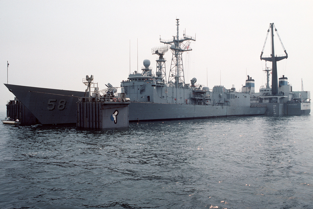 A port bow view of the damaged guided missile frigate USS SAMUEL B. ROBERTS (FFG-58) as the Dutch heavy lift ship MIGHTY SERVANT II floods its decks prior to releasing the frigate. The SAMUEL B. ROBERTS was struck by an Iranian mine while on patrol in the Persian Gulf