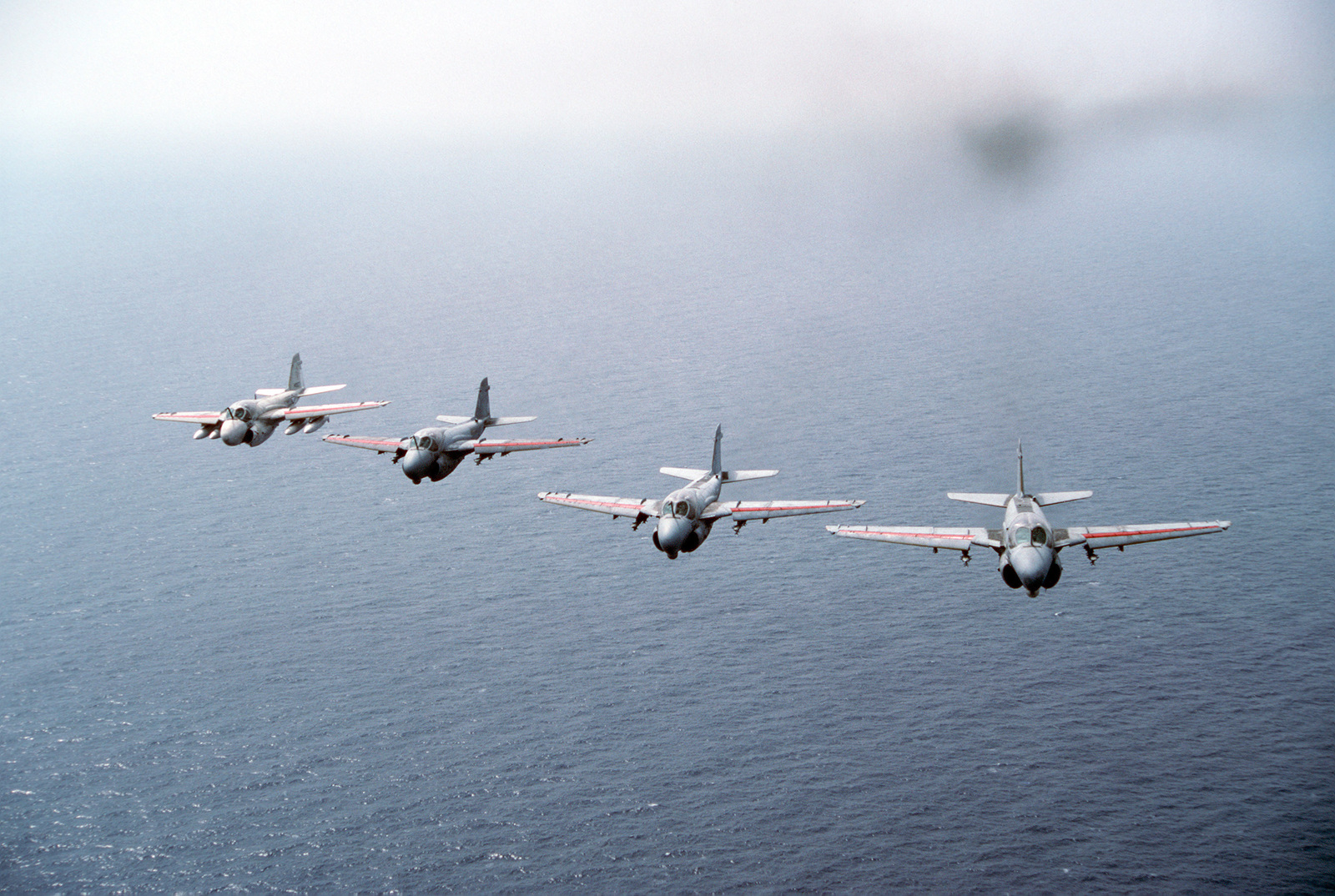 An air-to-air front view of a flight of one KA-6D Intruder and three A-6E Intruder aircraft from Attack Squadron 34 (VA-34) during their deployment aboard the aircraft carrier USS DWIGHT D. EISENHOWER (CVN 69)