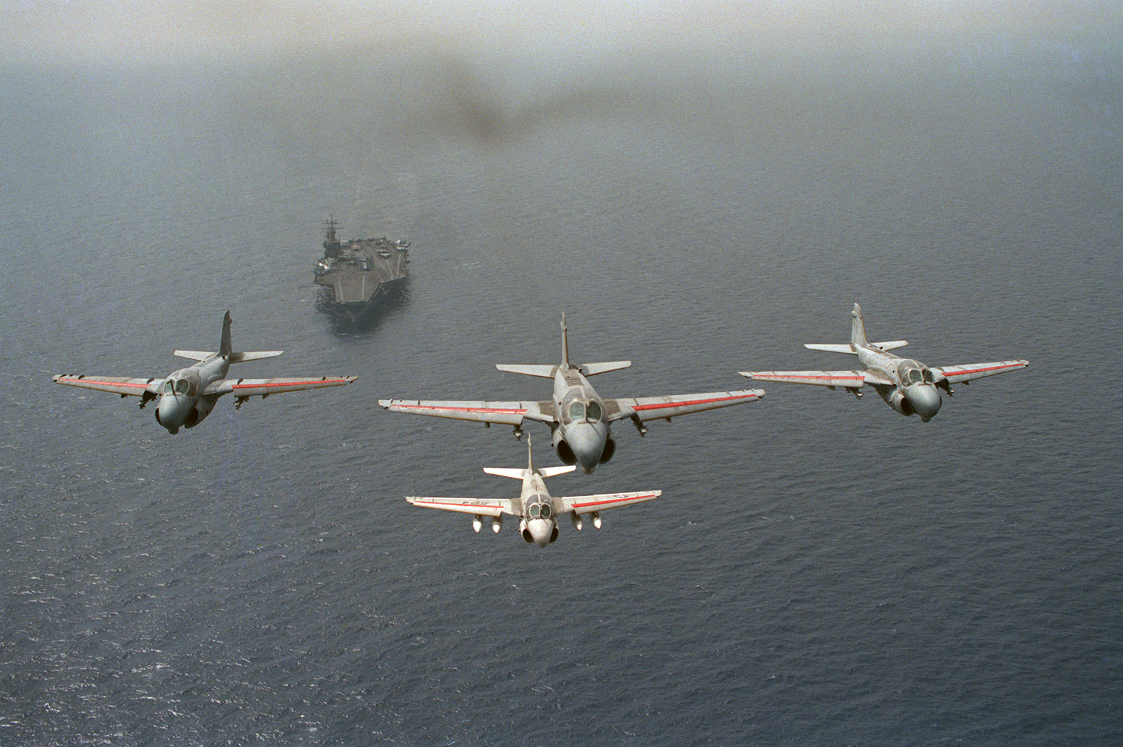 An air-to-air front view of four Attack Squadron 34 (VA-34) A-6E Intruder aircraft in formation over the nuclear-powered aircraft carrier USS DWIGHT D. EISENHOWER (CVN 69).  Carrier Air Wing 7 (CVW-7) is assigned to the EISENHOWER, which is in the Mediter