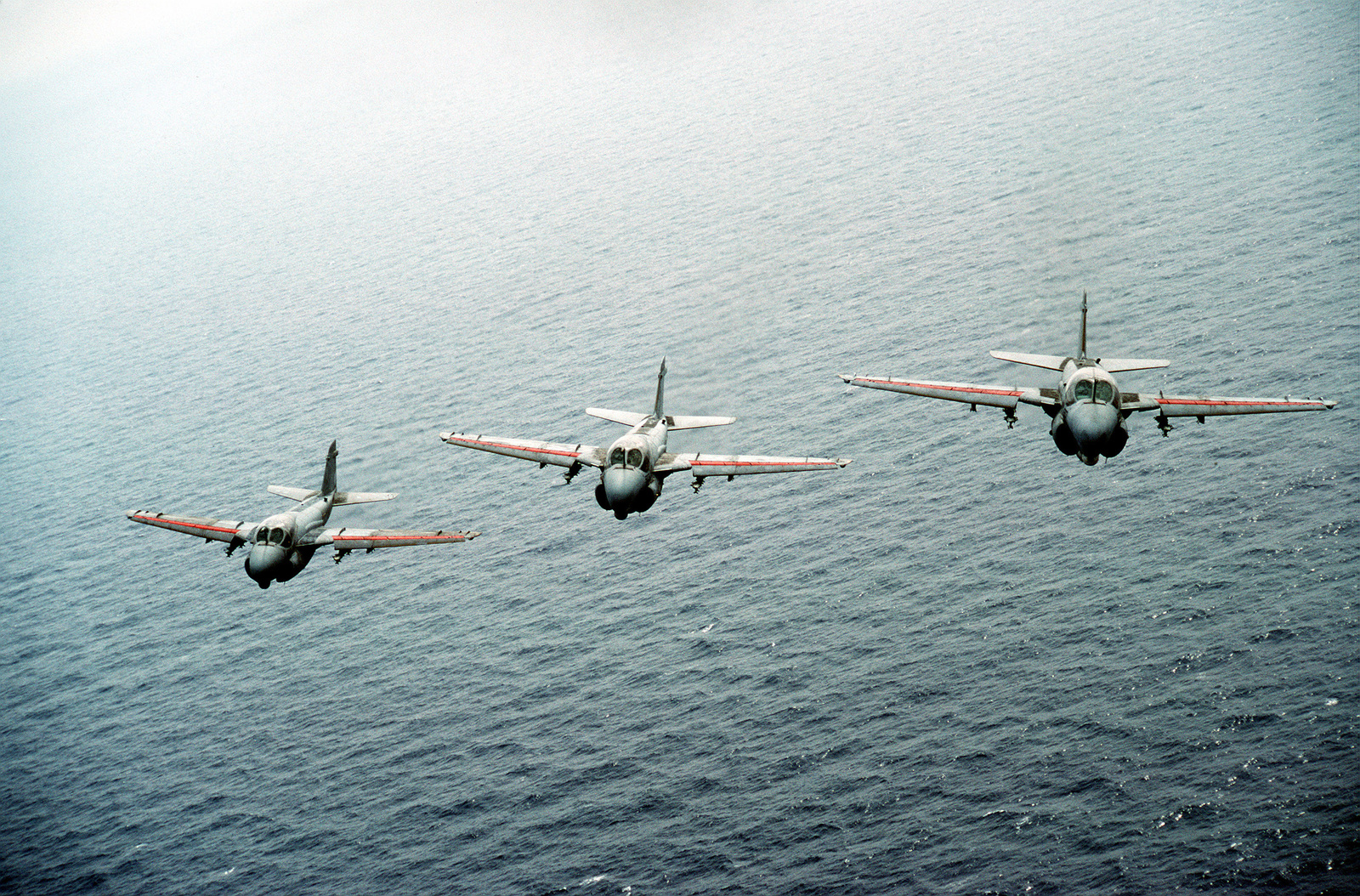 An air-to-air front view of three A-6E Intruder aircraft from Attack Squadron 34 (VA-34) during their deployment aboard the USS DWIGHT D. EISENHOWER (CVN-69). Exact Date Shot Unknown