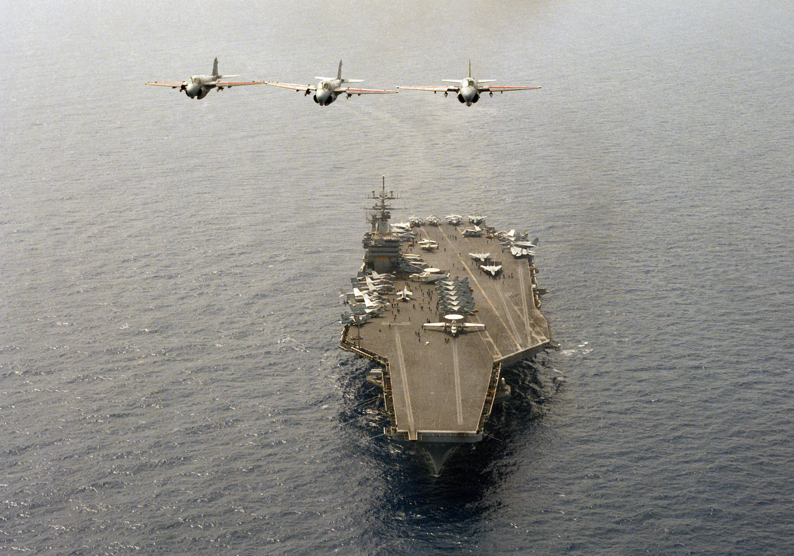 An air-to-air front view of three Attack Squadron 34 (VA-34) A-6E Intruder aircraft in formation over the nuclear-powered aircraft carrier USS DWIGHT D. EISENHOWER (CVN 69).  Carrier Air Wing 7 (CVW-7 is assigned to the EISENHOWER, which is in the Mediter