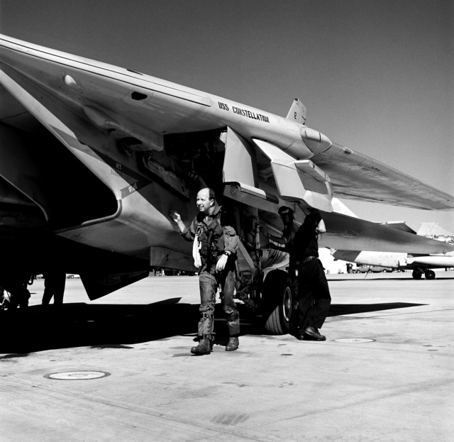 """Captain W.S. """"Bud"""" Orr, Commanding Officer, Carrier Air Wing 14 (CVW-14), conducts a preflight check of a Fighter Squadron 154 (VF-154) F-14A Tomcat aircraft prior to pre-deployment training mission"""