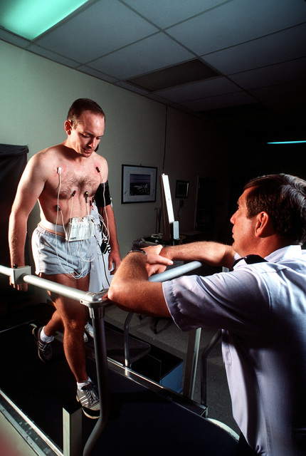 Colonel (Dr.) Michael Henderson monitors CAPT. Scott Frost's treadmill test in the clinical sciences division at the USAF School of Aerospace Medicine. Professionals in the division cardiac evaluation program conduct extensive tests on hundreds of aviators each year to locate cardiac problems