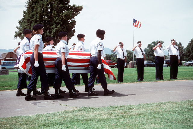An honor guard from Hill Air Force Base carries the casket at the funeral of COL Mark Lane Stephensen, whose RF-4C Phantom II aircraft crashed into a hillside while evading SAM missiles over North Vietnam in 1967. Twenty-one years later, the remains of 27 Americans killed in Southeast Asia, including COL Stephensen's, were repatriated by the government of Vietnam