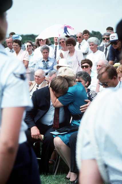 Gary Sigler embrace Vickie Stephensen at her husband's funeral. Sigler was in the back seat of then-Major Stephensen's RF-4C Phantom II aircraft when it flew into a hillside while evading SAM missiles over North Vietnam in 1967. Sigler ejected in time; he was captured and held prisoner for seven years. COL Stephensen's remains were repatriated in 1988