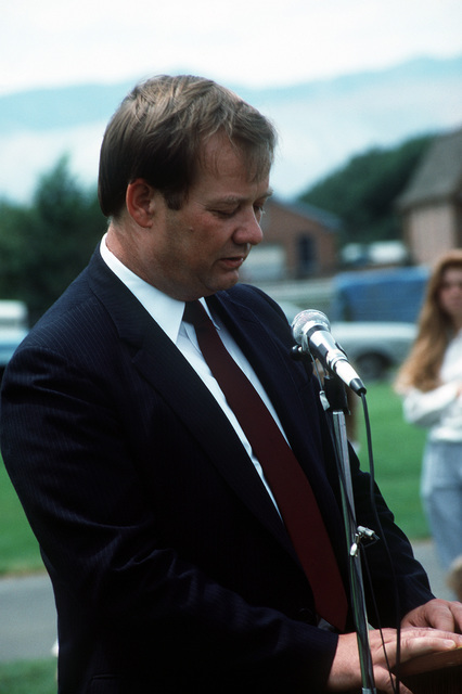 Gary Sigler speaks at the funeral of COL Mark Lane Stephensen, whose RF-4C Phantom II aircraft crashed into a hillside while evading SAM missiles over North Vietnam in 1967. Sigler, who ejected from the back seat of the Phantom, was captured and held prisoner for seven years. In 1988 the remains of Stephensen and 26 other Americans killed in Southeast Asia were repatriated by the government of Vietnam