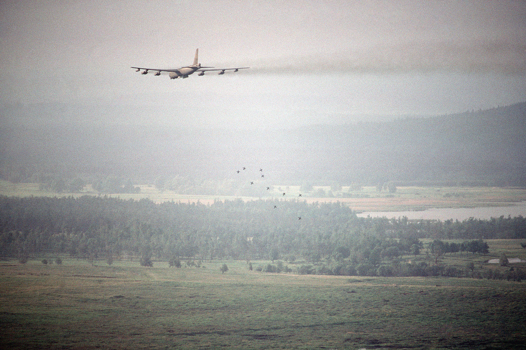 A rear view of a B-52 Stratofortress aircraft from the 2nd Bomb Wing, dropping Mark 82 high-drag bombs as part of a flight training mission during a Strategic Air Command Exercise BUSY BREWER