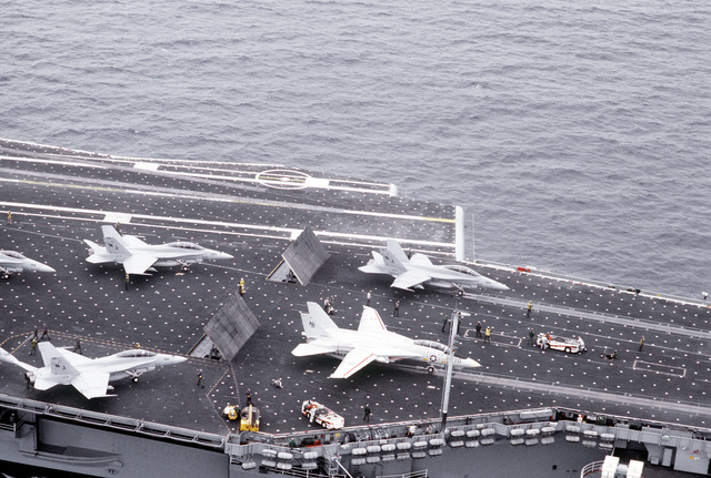 F/A-18 Hornet and F-14 Tomcat aircraft prepare for launching on the flight deck of the aircraft carrier USS CONSTELLATION (CVB-64)