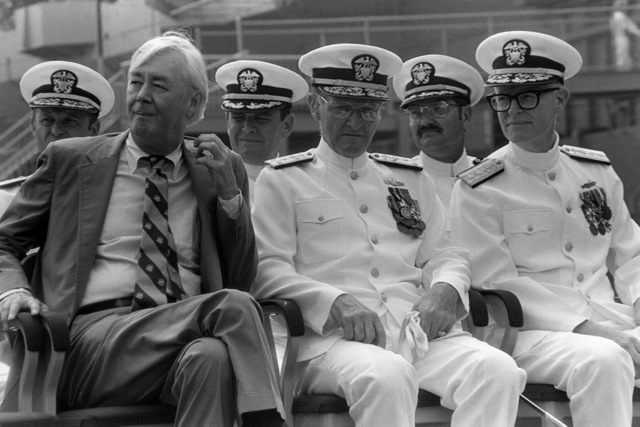 Senator Daniel P. Moynihan, Democrat-New York, Vice Admiral (VADM) William H. Rowden, commander, Naval Sea Systems Command, and Rear Admiral (RADM) (upper half) Grant A. Sharp, assistant deputy chief of naval operations, Surface Warfare, listen to a speaker during the commissioning of the guided missile cruiser USS LAKE CHAMPLAIN (CG 57)