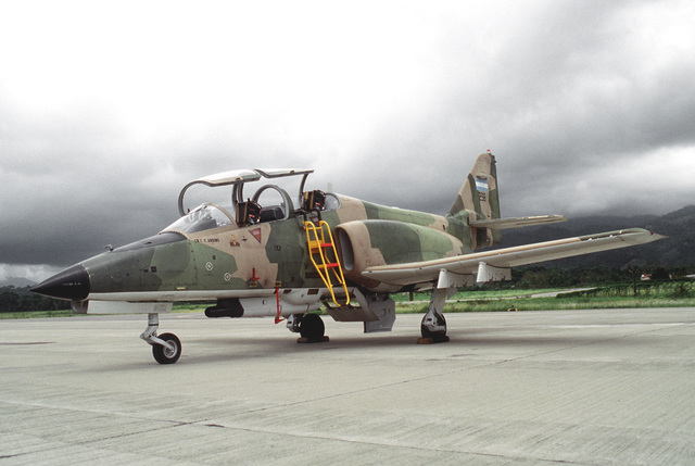 A C-101 Aviojet aircraft of the Honduran air force sits on the flight line with its canopy open. Some of these Spanish-designed trainer/light attack jets in service in South America are manufactured under license in Chile
