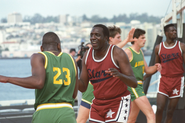 The San Diego Stars play an exhibition game on a regulation basketball court set up on the flight deck of the aircraft carrier USS RANGER (CV-61). Meadowlark Lemon (center) is the star player. The event was attended by crew members and families of the carriers USS CONSTELLATION (CV-64), USS ENTERPRISE (CVN-65) and invited guests of the San Diego Naval Training Center (NTC). The game was sponsored by the San Diego Sports Arena in cooperation with ESPN Sports network