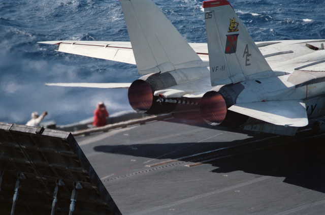 A Fighter Squadron 11 (VF-11) F-14A Tomcat aircraft prepares for launch from the flight deck of the aircraft carrier USS FORRESTAL (CV 59) during Exercise WEST WIND 88.  A jet blast deflector panel is raised behind the aircraft