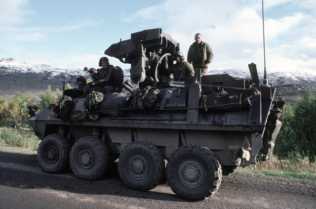 A light armored command and control vehicle (LAV25) from the 2nd Battalion moves along Highway 6 during Exercise TEAMWORK'88.  Pictured in the vehicle are:  Lance Corporal (LCPL) Everett Whittaker, driver; Corporal (CPL) Robert Williams, vehicle commander; LCPL Frank Gonzalez, gunner; and LCPL Aaron Jenkins, loader