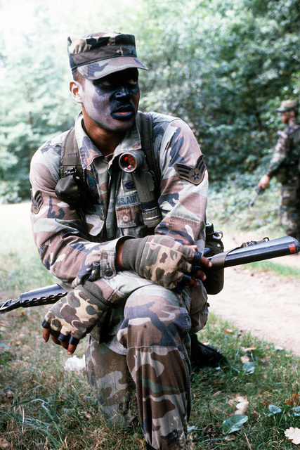 A sergeant from the 436th Security Police Squadron (436th SPS) rests his M-16A1 rifle on his thigh as he pauses during a patrol. Members of the 436th SPS were flown in from Dover Air Force Base, Del., to participate in Exercise Creek Warrior '88
