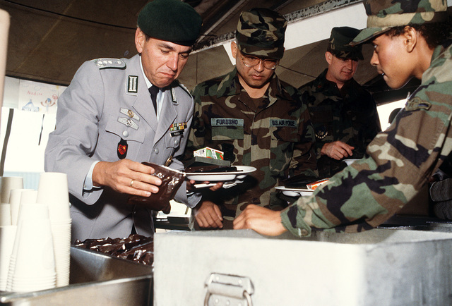 COL. Reibold, commander of West German military counter-intelligence group, selects a Meal, Ready-to-Eat (MRE) entree from a box. Some German forces are being used to supplement American assets for Exercise Creek Warrior '88