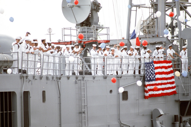 Crew members manning the rails applaud as the guided missile frigate USS STARK (FFG 31) returns to its home port.  The STARK has just completed sea trials that followed a stay at the Ingalls Shipbuilding facility in Pascagoula, Mississippi, for repairs to the extensive damage caused by two Iraqi-launched Exocet anti-ship missiles that struck the ship while it was on patrol in the Persian Gulf in May 1987.  Thirty-seven crewmen were killed in the explosion and fires
