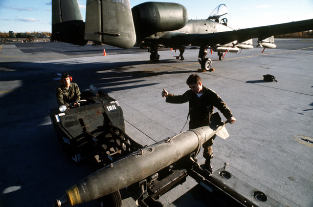 During CALFEX IV weapons loading personnel assigned to the 343rd AMU, Eielson AFB, Alaska load bombs on a A-10 aircraft during the joint Army and Air Force combined live fire exercise at the Yukon Command Training Site. Exact Date Shot Unknown