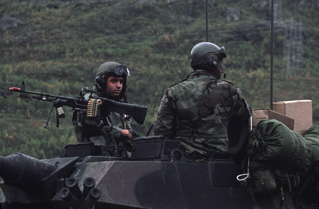 Lieutenant (LT) Scott Bamonte, machine gunner, and Lance Corporal (LCPL) Roderick Davis, gunner, members of the 2nd Battalion, observe the operations area along Highway 6 from a light armored command and control vehicle (LAV25) during Exercise TEAMWORK'88