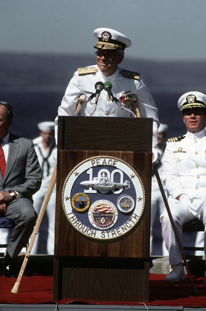 Rear Admiral (RDML) (lower half) George W. Davis VI, commander, Submarine Group 9 and Naval Base, Seattle speaks at the welcoming ceremony for the nuclear powered strategic missile submarine USS ALABAMA (SSBN 731) following the vessel's return to port after completing the 100th Trident ballistic missile submarine patrol