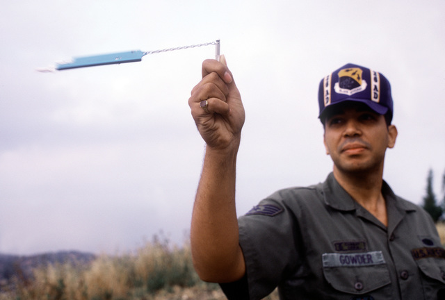 STAFF SGT. Paul Gowder uses a spychrometer to check the dew point used in determining the radar's refractive index on the San Pedro Joint Surveillance System. The system, operated by the Air Force and maintained by the FAA, detects unauthorized aircraft and manages air traffic control