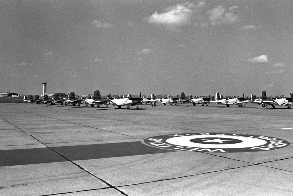 T-34C Mentor aircraft line the airfield after they were flown to the base to avoid the possibility of being damaged by Hurricane Gilbert. The planes are U.S. Navy aircraft from Training Wing 4, based at Corpus Christi, Texas