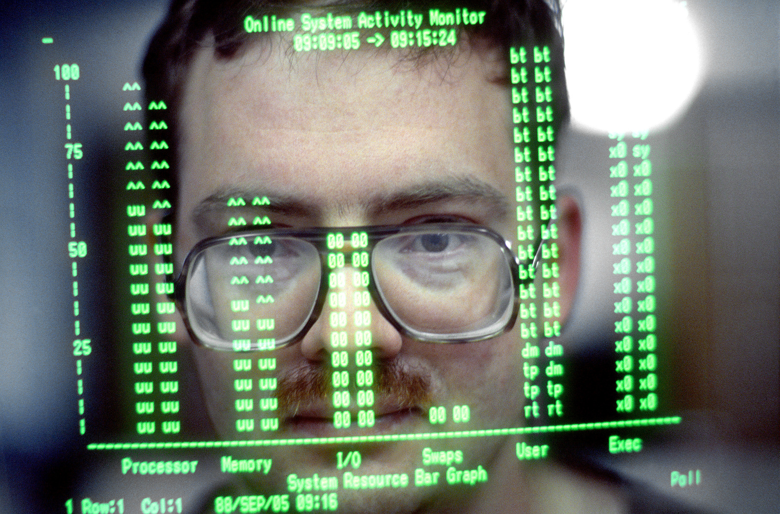 The face of a computer operator from the 2134th Communications Squadron is reflected on the screen of his video display terminal. The operator is working in a transportable shelter during exercise Creek Warrior '88. Exact Date Shot Unknown