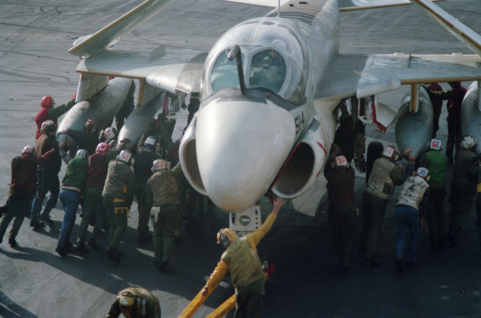 An A-6E Intruder aircraft is maneuvered into place on the flight deck of the aircraft carrier USS FORRESTAL (CV 59) in the North Atlantic Ocean during Exercise WEST WIND 88
