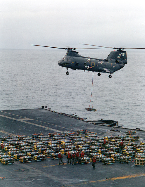 A Helicopter Combat Support Squadron 6 (HC-6) CH-46 Sea Knight helicopter picks up ammunition from the aircraft carrier USS FORRESTAL (CV-59) during exercise Team Work '88