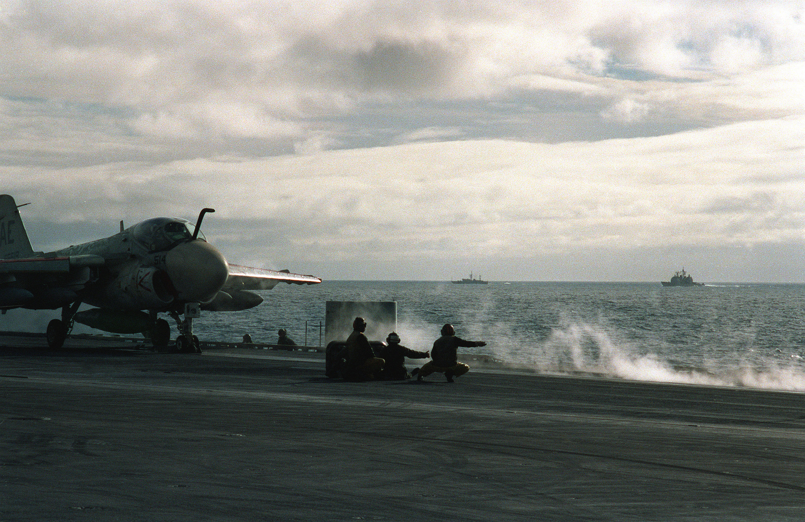 Steam rises from a catapult as an A-6E Intruder aircraft is prepared for launch from the aircraft carrier USS Forrestal (CV-59) during exercise Team Work '88