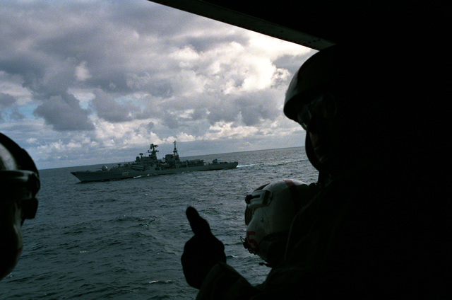 Crewmen aboard a US Navy helicopter observe a Soviet Sovremenny class guided missile destroyer. The destroyer is operating in the area of the USS FORRESTAL (CV 59) battle group, which is participating in exercise WEST WIND '88